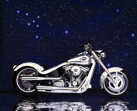 MOT 01 RK0007 15 © Kimball Stock 90's Radical Custom Big Twin Softail Profile Silver Showering Stars Background