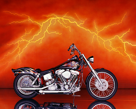 MOT 01 RK0009 03 © Kimball Stock 1997 Custom Harley Profile With Orange Lightning In Background
