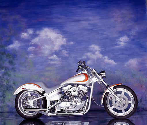MOT 01 RK0024 06 © Kimball Stock Silver And Red Sportster Softail Custom Bike Profile Clouds Background