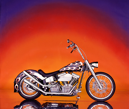 MOT 01 RK0025 03 © Kimball Stock 90's Ness Softail Custom With Flames Profile Sunset Background