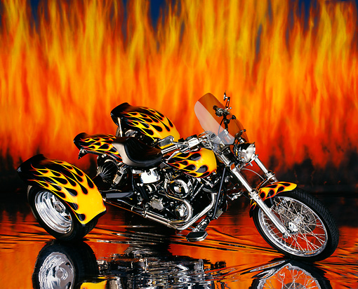 MOT 01 RK0042 08 © Kimball Stock 1980 Black Harley Davidson Custom Trike With Red And Yellow Flames Profile View Flames