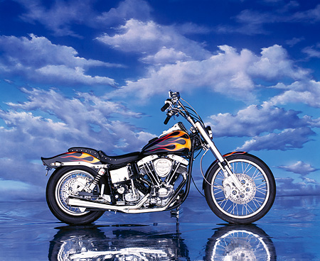MOT 01 RK0044 05 © Kimball Stock Black Modified Shovelhead With Orange Flames Profile  On Mylar Floor Blue Clouds
