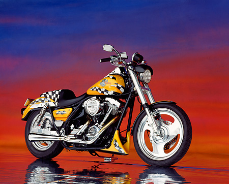 MOT 01 RK0059 02 © Kimball Stock Yellow Checkered RevTech FXLR Bike 3/4 Side View On Mylar Floor Sunset Background