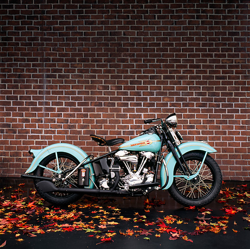 MOT 01 RK0076 07 © Kimball Stock 1938 Blue Harley-Davidson. Profile View Autumn Leaves Brick Wall Studio