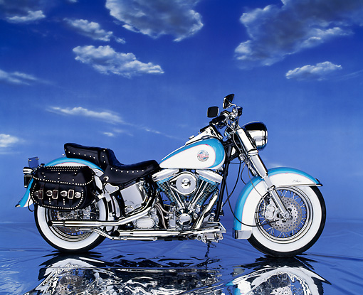 MOT 01 RK0140 08 © Kimball Stock 1991 Harley-Davidson Heritage Classic Light Blue And White Profile View Clouds