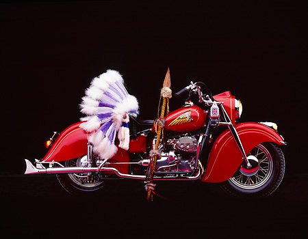 MOT 01 RK0150 01 © Kimball Stock 1941 841 Indian Motorcycle Red Profile With Headress Studio