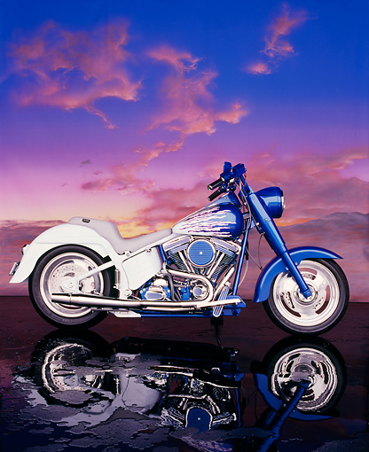 MOT 01 RK0243 05 © Kimball Stock 1995 Harley-Davidson Fat Boy Blue And White Profile View Sunset Clouds