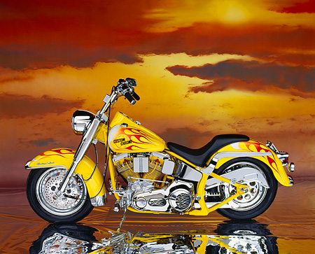 MOT 01 RK0284 03 © Kimball Stock 90's Custom Chrome Big Twin Softail Yellow With Flames Profile Sunset Clouds