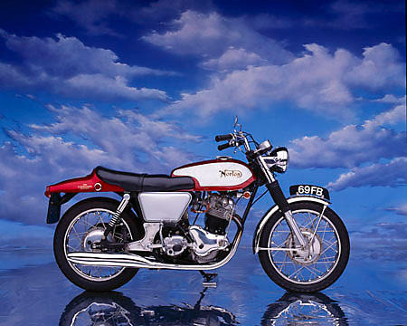MOT 01 RK0333 06 © Kimball Stock 1969 Norton Fastback 750 Commando Red Profile View On Mylar Floor Cloudy Blue Sky Background
