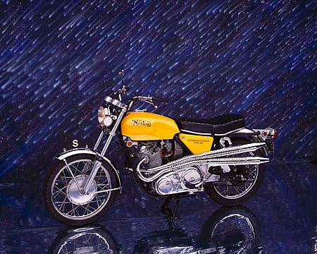 MOT 01 RK0335 02 © Kimball Stock 1970 Norton S Type 750 Commando Yellow 3/4 Front View On Mylar Floor Meteor Shower Background