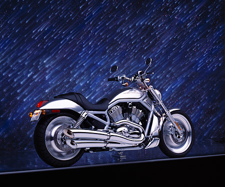 MOT 01 RK0345 01 © Kimball Stock 2002 Harley Davidson V-Rod Silver 3/4 Rear View On Gray Line Meteor Shower Studio