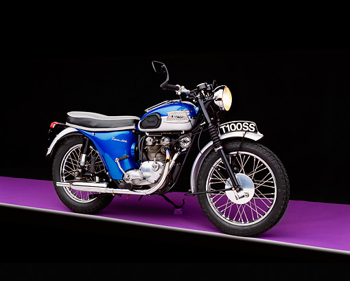 MOT 01 RK0382 02 © Kimball Stock 1962 Triumph T100SS Motorcycle Blue 3/4 Side View On Purple Floor Studio