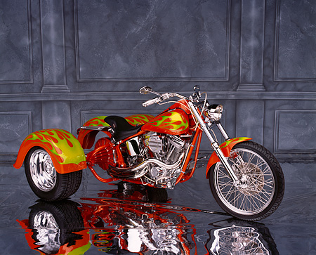 MOT 01 RK0434 08 © Kimball Stock Harley-Davidson Trike Orange With Green Flames Side 3/4 View On Mylar Floor Gray Marble