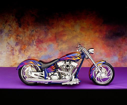 MOT 01 RK0502 03 © Kimball Stock 2002 Riff Raff Custom Motorcycle Purple With Flames Profile View On Purple Floor Mottled Background