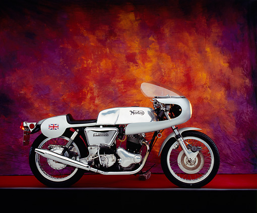 MOT 01 RK0525 05 © Kimball Stock 1972 Norton Combat 750 Silver Side View On Red Floor Mottled Background