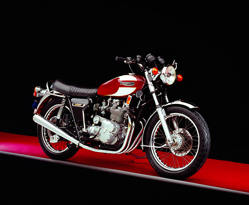 MOT 01 RK0553 02 © Kimball Stock 1975 Triumph Trident Maroon And White 3/4 Side View On Red Floor Studio