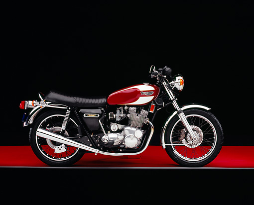 MOT 01 RK0554 02 © Kimball Stock 1975 Triumph Trident Maroon And White Side View On Red Floor Gray Line Studio