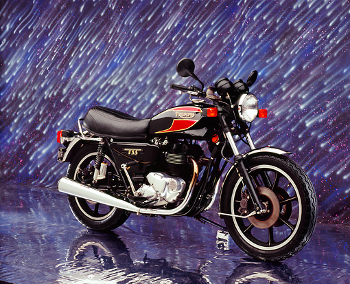 MOT 01 RK0560 03 © Kimball Stock 1983 Triumph TSS Black And Red 3/4 Side View On Mylar Floor Night Showers