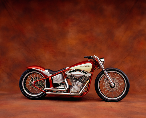 MOT 01 RK0577 07 © Kimball Stock 2004 V Twin Softail Orange And Cream Side View On Brown Mottled Background