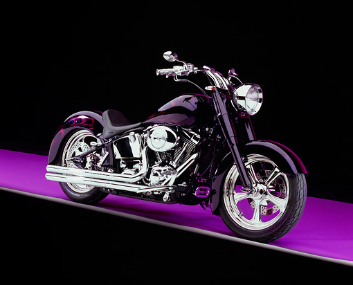 MOT 01 RK0600 06 © Kimball Stock 2000 Harley Davidson, Fat Boy, Black With Flames 3/4 Side View On Purple Floor Studio