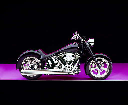 MOT 01 RK0601 09 © Kimball Stock 2000 Harley Davidson, Fat Boy, Black With Flames Profile View On Purple Floor Studio