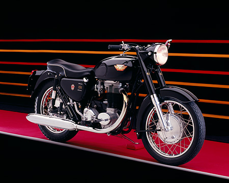 MOT 01 RK0610 03 © Kimball Stock 1966 Matchless, G80, Black Motorcycle 3/4 Side View On Red Floor Colorful Lines Studio