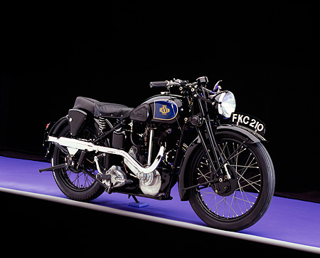 MOT 01 RK0618 02 © Kimball Stock 1939 Levis, 600, Black Motorcycle 3/4 Side View On Purple Floor Studio