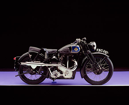 MOT 01 RK0619 02 © Kimball Stock 1939 Levis, 600, Black Motorcycle Profile View On Purple Floor Studio