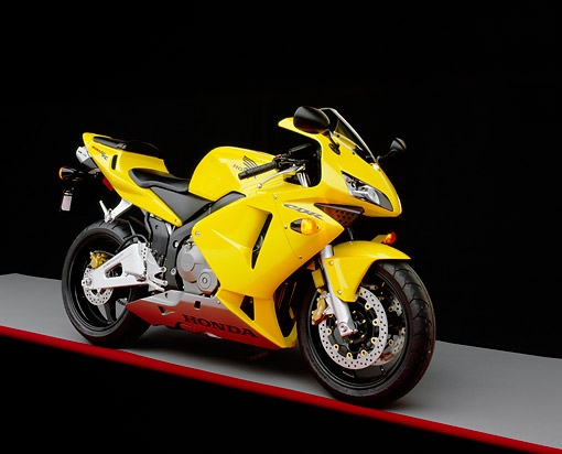MOT 02 RK0109 02 © Kimball Stock 2003 Honda CBR 600RR Yellow Side 3/4 View On Gray Floor Red Line Studio