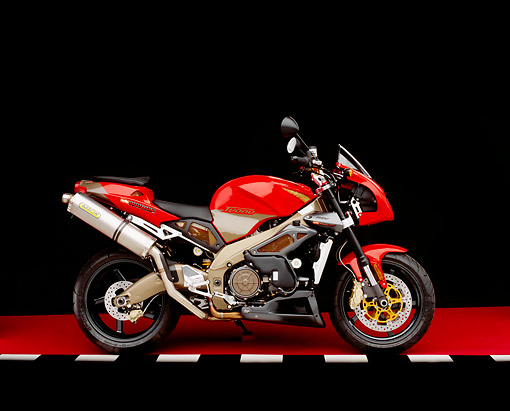 MOT 02 RK0114 09 © Kimball Stock 2003 Aprilia Tuono 1000cc Red Side View On Red Floor Checkered Line Studio