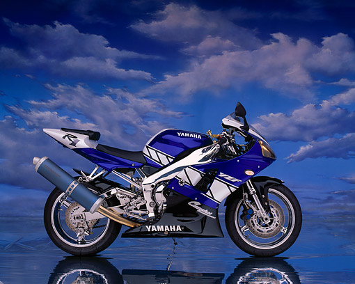 MOT 02 RK0142 01 © Kimball Stock 2001 Yamaha R1 Champions Edition Blue Side View On Mylar Floor Clouds Background Studio