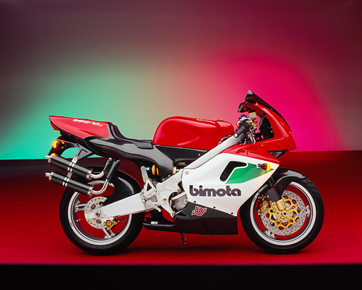 MOT 02 RK0157 07 © Kimball Stock 1997 Bimota 500-V Red And White Side View On Red Floor Green And Red Lighting Studio