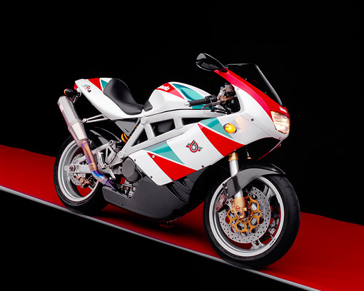 MOT 02 RK0161 06 © Kimball Stock 1999 Bimota DB4 Red Green And White 3/4 Side View On Red Floor Gray Line Studio