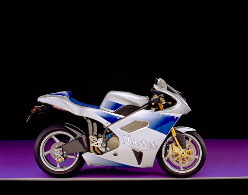 MOT 02 RK0191 05 © Kimball Stock 2003 Mondial Piega Blue And Silver Side View On Purple Floor Gray Line Studio