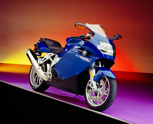MOT 02 RK0263 03 © Kimball Stock 2005 BMW K1200S Blue 3/4 Front View On Purple Floor Colorful Background Studio