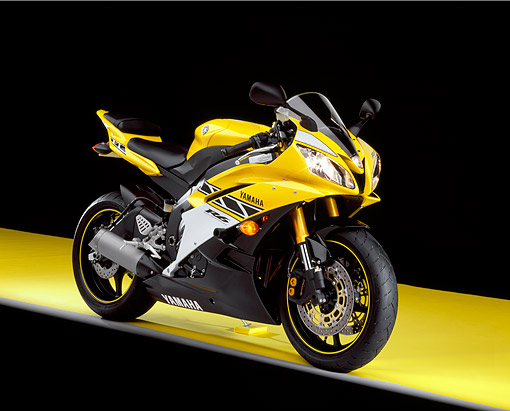MOT 02 RK0286 05 © Kimball Stock 2006 Yamaha YZF 600 R6 Yellow 3/4 Side View On Yellow Floor Studio