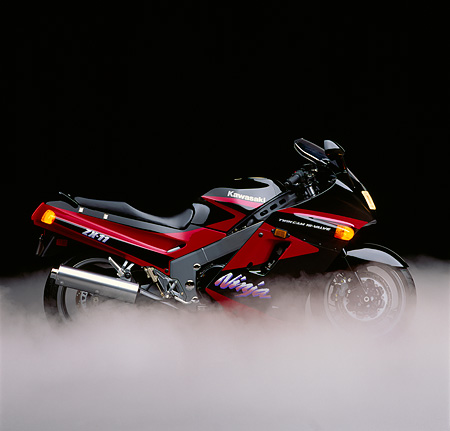 MOT 02 RK0048 01 © Kimball Stock Kawasaki Ninja ZX-11. Black/red profile in studio with smoke on floor
