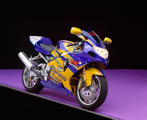 MOT 02 RK0080 02 © Kimball Stock 2001 Suzuki GSXR 1000 Corona Replica 3/4 Front View On Purple Floor Studio