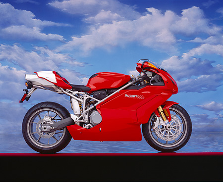 MOT 02 RK0125 08 © Kimball Stock 2004 Ducati 999s Red Profile Mylar Floor Cloudy Blue Sky Background Studio