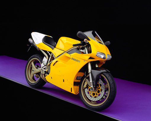 MOT 02 RK0151 01 © Kimball Stock 1998 Ducati 748 Yellow 3/4 Front View On Purple Floor Studio