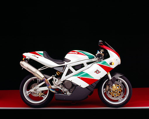 MOT 02 RK0162 04 © Kimball Stock 1999 Bimota DB4 Red Green And White Profile View On Red Floor Gray Line Studio