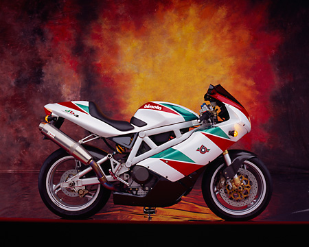 MOT 02 RK0164 02 © Kimball Stock 1999 Bimota DB4 Red Green And White Profile View Studio
