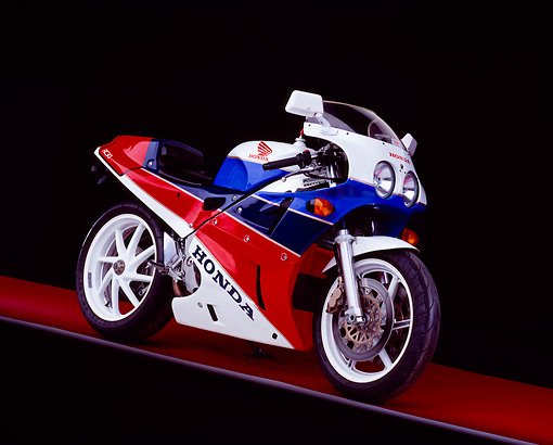 MOT 02 RK0215 01 © Kimball Stock 1990 Honda RC30 Red White And Blue 3/4 Side View On Red Floor Gray Line Studio
