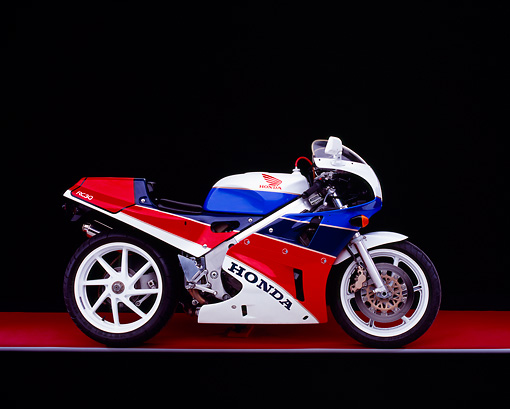 MOT 02 RK0216 01 © Kimball Stock 1990 Honda RC30 Red White And Blue Side View On Red Floor Gray Line Studio