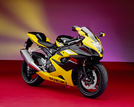 MOT 02 RK0230 06 © Kimball Stock 2005 Suzuki GSXR 1000 Black And Yellow 3/4 Side View On Red Floor Yellow Purple Lights Studio