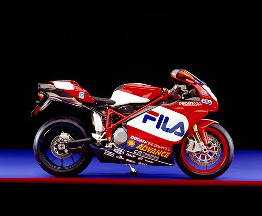MOT 02 RK0237 04 © Kimball Stock 2004 Ducati 999R FILA Red And White Profile View On Purple Floor Red Line Studio