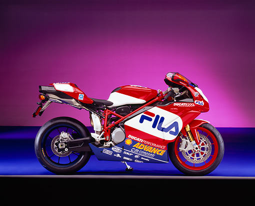 MOT 02 RK0238 03 © Kimball Stock 2004 Ducati 999R FILA Red And White Profile View On Purple Floor And Shading Gray Line Studio