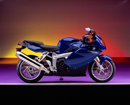 MOT 02 RK0264 10 © Kimball Stock 2005 BMW K1200 Blue Profile View On Purple Floor Colorful Background Studio