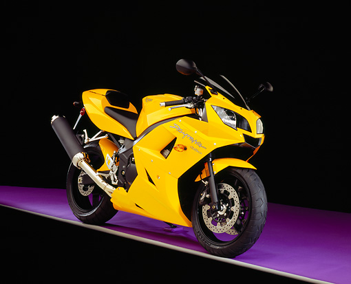 MOT 02 RK0267 07 © Kimball Stock 2005 Triumph Daytona 650 Yellow 3/4 Front View On Purple Floor Studio