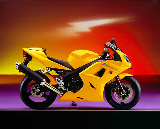 MOT 02 RK0270 02 © Kimball Stock 2005 Triumph Daytona 650 Yellow Profile View On Purple Floor Lightning Background Studio
